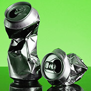Crushed cans represent weakened aluminum